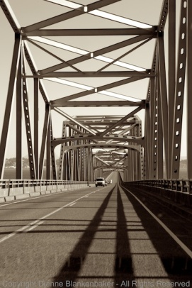 DSLR. The shadows create intense leading lines that take us down into the bridge