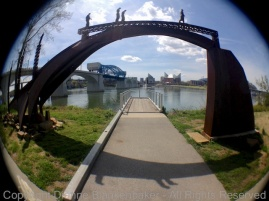 iPhone 4S with Camera Awesome and fisheye lens attachment. Same sidewalk in earlier example used in a different way.