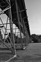 DSLR. The bridge forms its own leading line