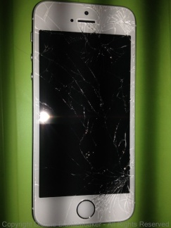 Shattered screen of iPhone 5S taken with the 4S
