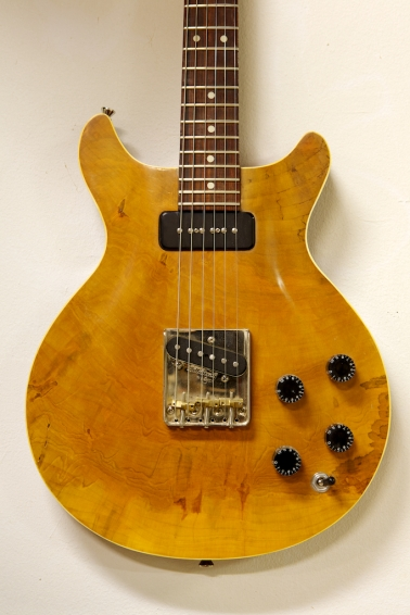 Guitar body capped with wood from a historic tree