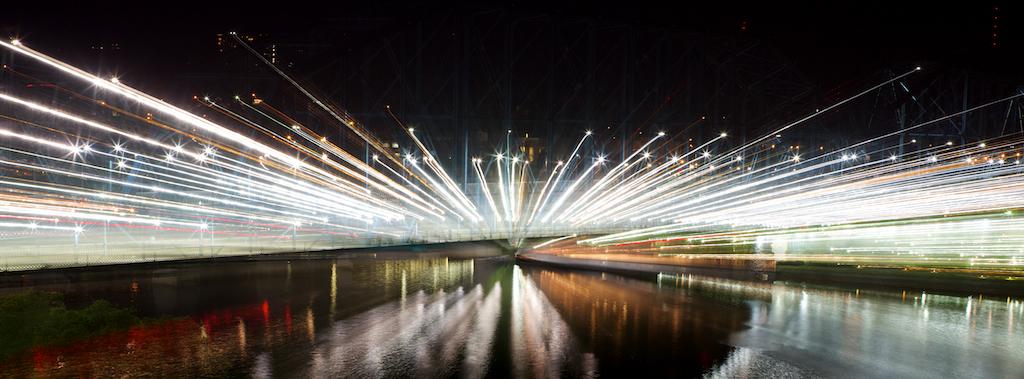 Lights on the Market Street and Walnut Street bridges with a blur